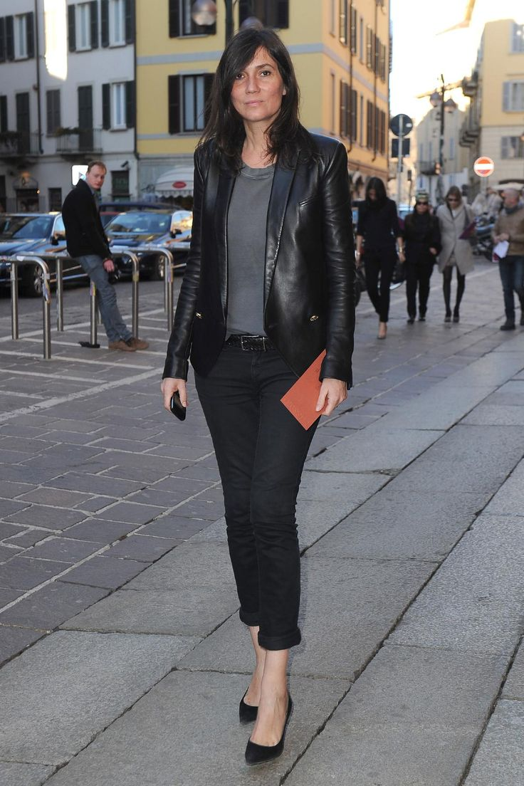 "Unlike her predecessor, French Vogue editor-in-chief Emmanuelle Alt believes ""you can make very strong fashion pictures without shocking."" The editors' personal styles are also at odds. At a lanky 6 feet, Alt favors a no-nonsense garçonne uniform of slim pants, button-downs, and blazers. Eschewing skirts and dresses, she wears minimal makeup and her hair loose, proving that sometimes simple is best."