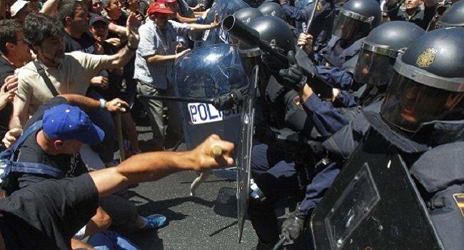 Scontri a Madrid: termina in un bagno di sangue la marcia per la dignità - The Nest gallery