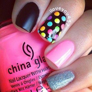 I love the idea of having one multi colored polka dot nail