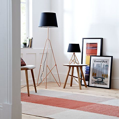 This Scandinavian inspired floor lamp is perfect for creating that modern look in your home.
