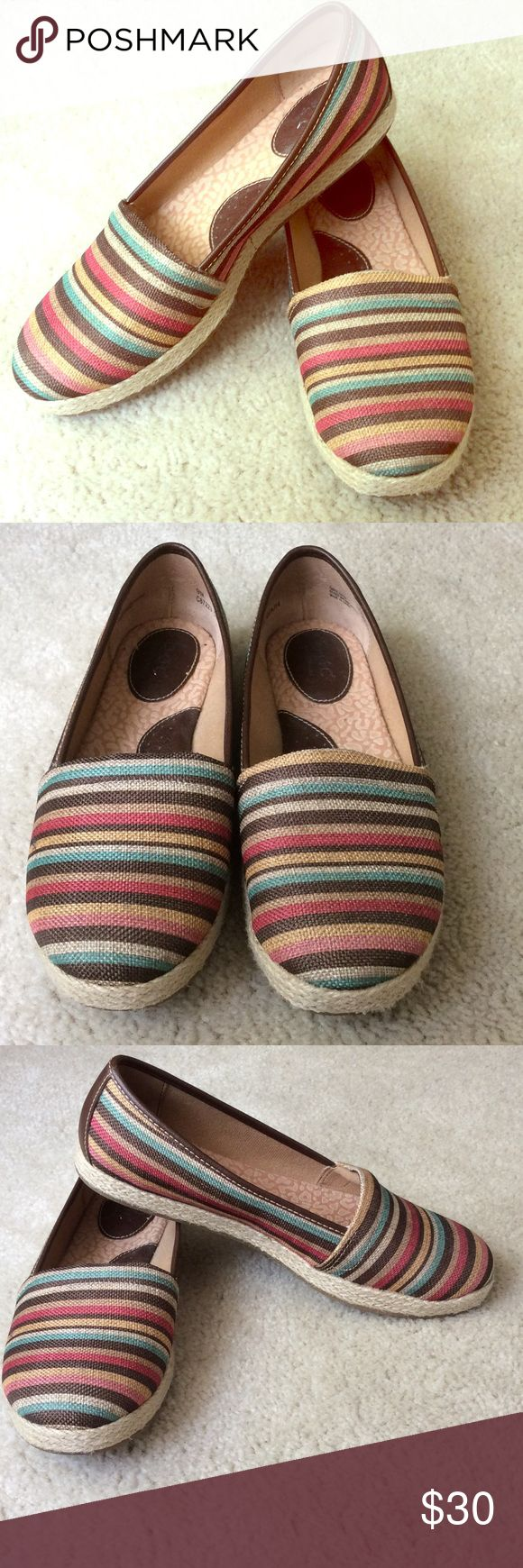 Born (BOC) Espadrilles multicolor canvas upper. Born (BOC) Espadrilles with muted pink, corral, teal, yellow, brown, and beige stripes on sturdy canvas (not flimsy!) with weave around base of the shoe. Great for year round! Clean and smoke free home. Barely worn! Great with jeans, shorts, capris and skirts! Born Shoes Espadrilles