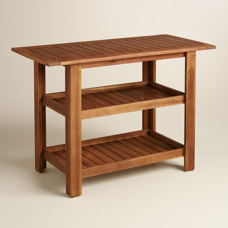 With three surfaces to keep plates, food and drinks handy, our serving table helps you entertain outdoors with ease. Crafted of solid acacia wood, this compact piece also doubles as a small-space dining table - perfect for the porch or balcony.