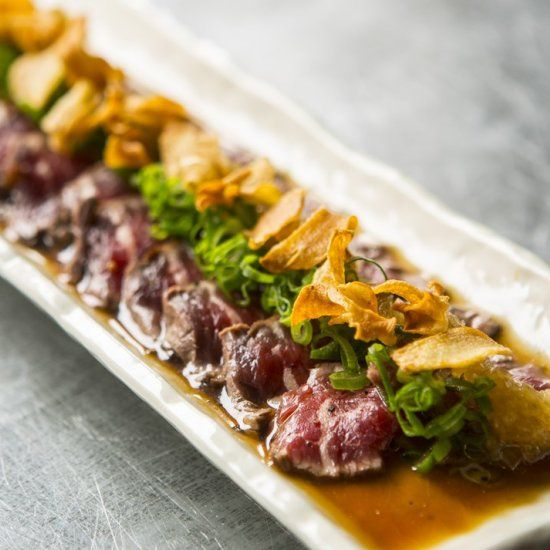 Scott Hallsworth opts for a moderately aged piece of beef fillet for his Japanese starter, serving it alongside tangy ponzu sauce.