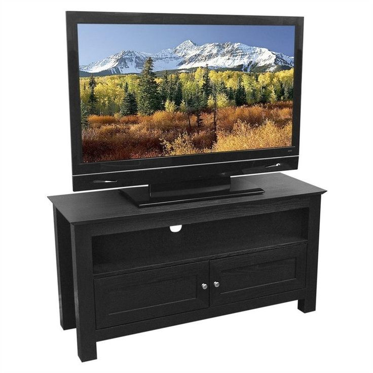 Elegance and function combine to give this 44-inch Flat Screen TV Stand in Black Wood Grain Finish a striking appearance. The design gives a stylish modern look crafted with durable PVC laminate and M