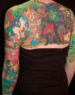 A Full Body Mural of Alice's A... is listed (or ranked) 2 on the list 29 Children's Book Tattoos That're Sure to Inspire Nostalgia