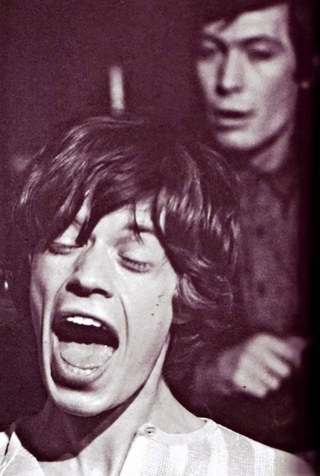 Rare Photos of a Young Mick Jagger from the 1960s and Charlie Watts in the background