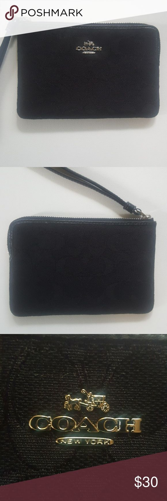 COACH Wristlet Black Monogram NWOT Black monogrammed wristlet in mint condition, never used. Coach New York with silver nameplate on the front. Still smells like the Coach store! Coach Bags Clutches & Wristlets