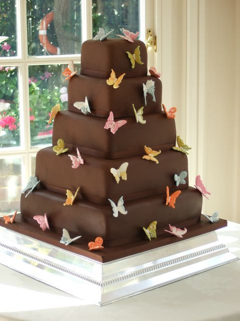 chocolate butterfly cake - just make butterflies with a cookie cutter and fondant