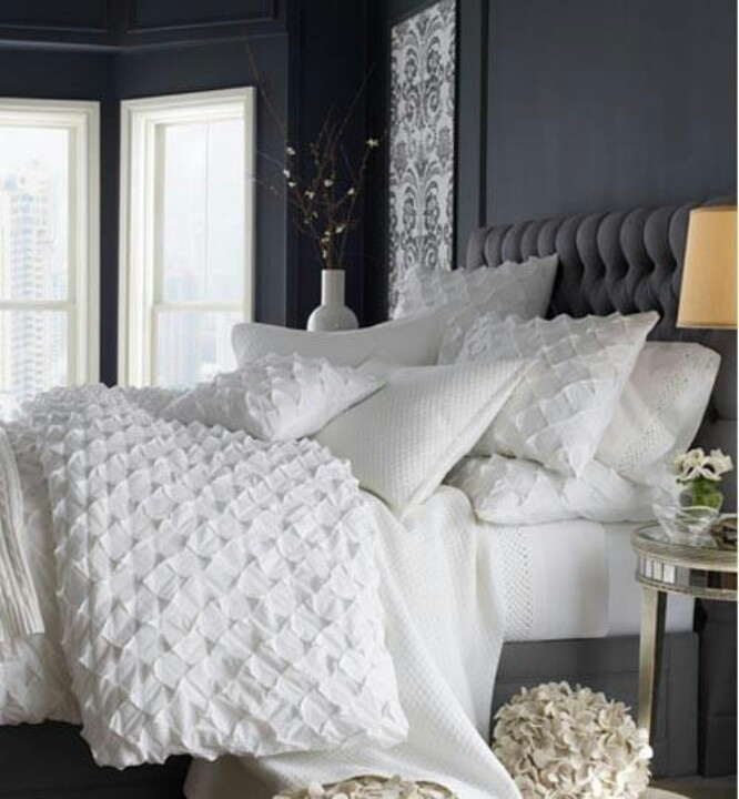 grey walls, white linens from the curtains to the bed and maybe white carpet.