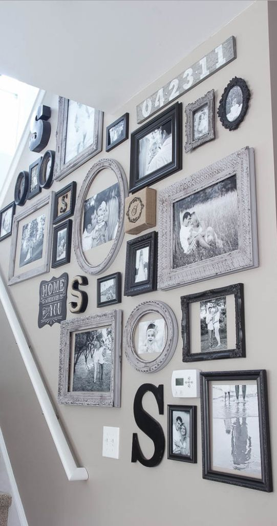 This gallery wall is that constant reminder of everything that's most important to any of us. It seems appropriate that it's displayed in the very center of the house. --------------- #gallery #wall #picture #frames #home #decor #tips #help #diy