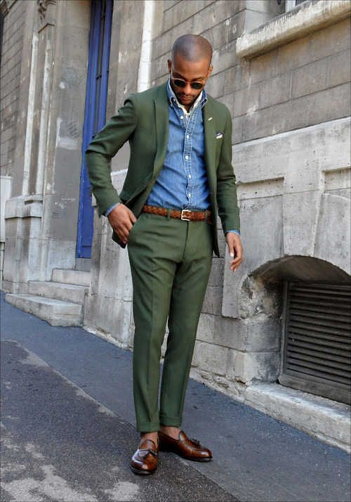 The denim shirt is a bad idea but a green linen suit is stylish.