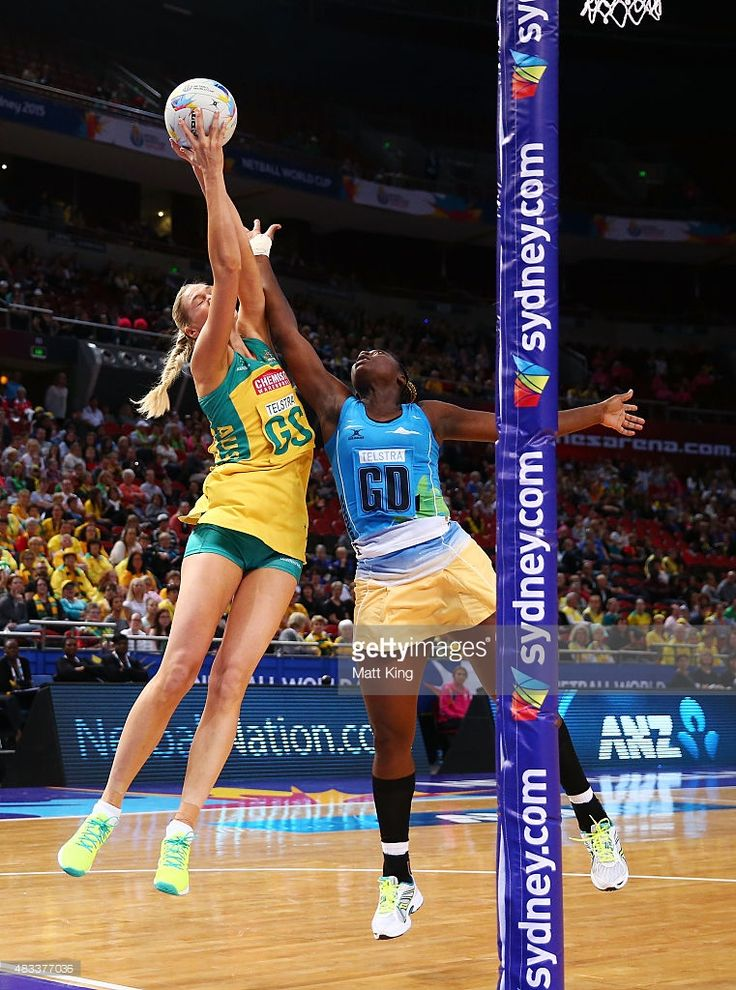 Caitlin Bassett of the Diamonds is challenged by Shonette Bruce of Barbados during the 2015 Netball World Cup match between Australia and Barbados at Allphones Arena on August 8, 2015 in Sydney, Australia.