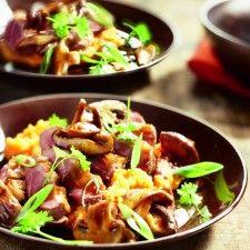 Eendenborst met paddenstoelen op wortelpuree