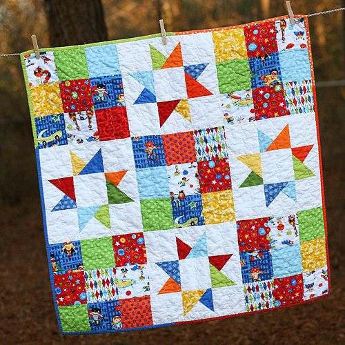Stars and Squares Superhero Baby Quilt by iguesssew,  Picture this in I Spy fabrics - squares cut 4-1/2 inches, blocks 12-inch finished)