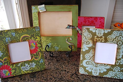 Frames covered with pretty paper and then distressed.