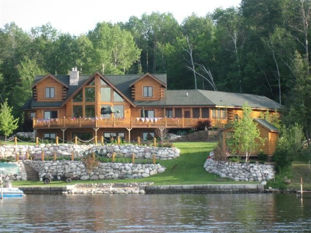 Dream house...log cabin on a lake in Colorado, just add mountains in the background and I'd be perfectly happy.