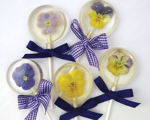 How To Make Hard Candy Lollipops With Edible Flowers  http://www.fancyflours.com/product/how-to-make-hard-candy-lollipops-with-edible-flowers/Spring_and_Easter_Themed_Recipes