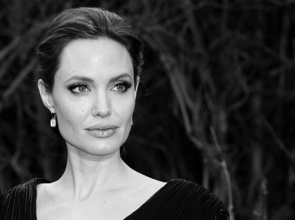 "Angelina Jolie Image has been converted to black and white.) Angelina Jolie attends a private reception as costumes and props from Disney's ""Maleficent"" are exhibited in support of Great Ormond Street Hospital at Kensington Palace on May 8, 2014 in London, England."