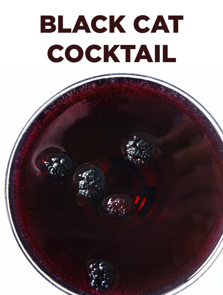 This Black Cat Cocktail is a sweet and fizzy combo of vodka, soda, blackcurrant juice and Blue Curacao. #BiteMeMore #drinks #recipes