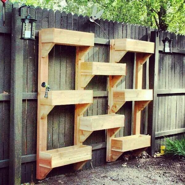 Cool idea for a small back yard. Vertical garden set up.