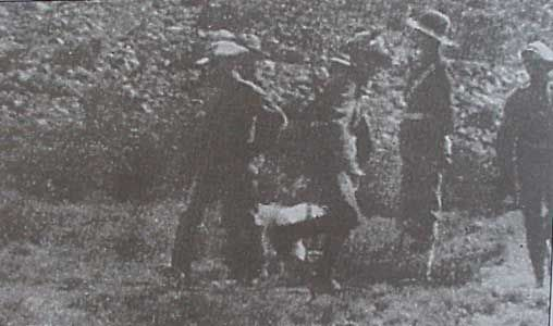 Photo taken secretly of Gideon Scheepers being tied to a chair. Photos were propably taken by Ivie H. Allen, who requested permission to photograph Scheepers' execution, but this was strictly forbidden. He nevertheless accompanied the military procession to the execution ground three miles out of Graaff-Reinet. Standing between the two rows of guards with a small Brownie camera under his coat, Allen had just enough space to photograph the execution without being seen by the officers.