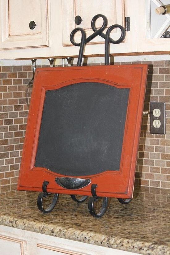 Chalk board made from a cabinet door. Love the upside down drawer pull for the chalk