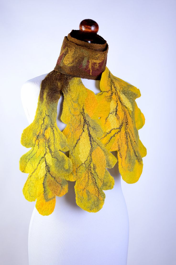This autumn leaf scarf with three oak leaves is felted by hand of natural merino wool. Its leaves are decorated with silk and linen fibers and scraps of silk fabric. It makes this fall scarf really beautiful. This is one of a kind design made just for one person and it is still in my stock. You can come and buy it anytime!