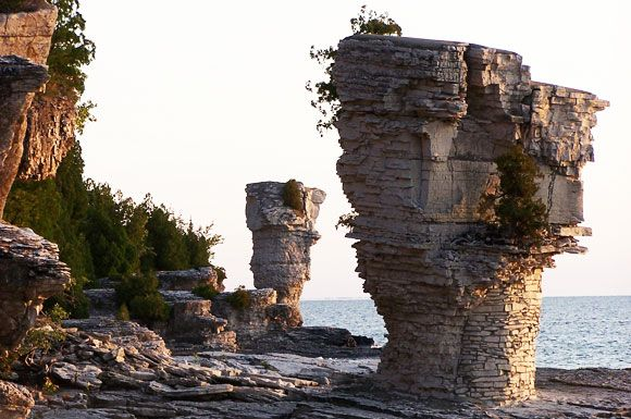 """A trip to Flowerpot Island is one of the best experiences in Fathom Five National Marine Park! The island is famous for its natural ""flowerpot"" rock pillars, caves, historic lightstation and rare plants. Most visitors take a tour boat from the town of Tobermory to spend a half or full day on the island hiking the trails, viewing the scenery, picnicking or swimming."""