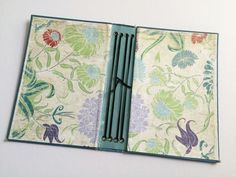 Clever use of old hardcover book to make a string journal (traveller's notebook).
