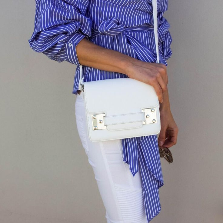 White cross body bag, blue and white stripe shirt, blue and white outfit, white jeans, spring/summer style @thelustlife_