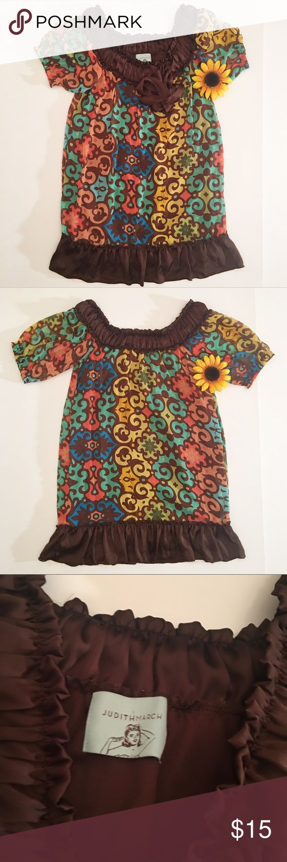 Brown/multi colored Judith March ruffle dress s Good used condition Judith March dress in a size small. Gorgeous brown ruffles with a multicolored print. The extra fabric near the neck ties into a bow. There are a few snags, like the one shown in the photo. They're not bad, just worth noting. Total length- approximately 32 inches, bust- approximately 14.5 inches. Judith March Dresses Midi