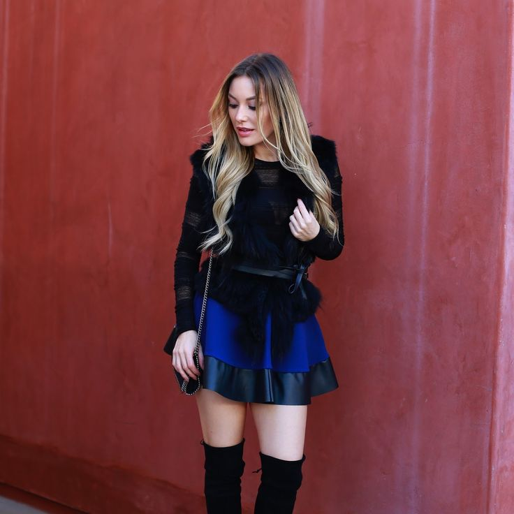 I love a feminine A-line skirt with over-the-knee boots. It reminds me of my uniform when I was a Catholic school girl! Granted my uniform w...