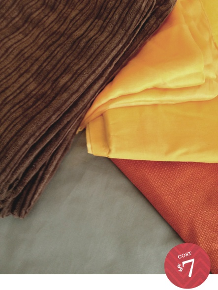 Accent colors. Curtains, pillows.     Chocolate brown corduroy standard shams, one for a regular pillow, one for a throw pillow. A taupey-grey twin sized flat sheet that I plan to remake into a duvet cover. Bright goldenrod fabric for accent pillows. And a burnt orange table cloth that is either going to find new life as a curtain or as a throw on the end of the bed. I haven't decided yet.