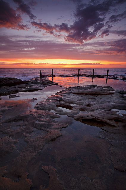Sunrise over Ivo Rowe Pool, near Coogee beach, Sydney Australia.