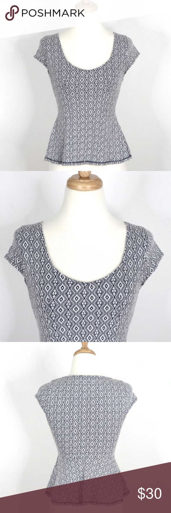 """POSTAGE STAMP Excellent condition and no defects.  Black white gray geometric print, wide scoop neck, short cap sleeves, peplum silhouette, cotton blend knit.  Approximately 15.25"""" across armpit seam to armpit seam (pictured) and 20"""" long.   Purchased at Anthropologie.  Automatically reduce price 20% for + bundles. Anthropologie Tops Tees - Short Sleeve"""