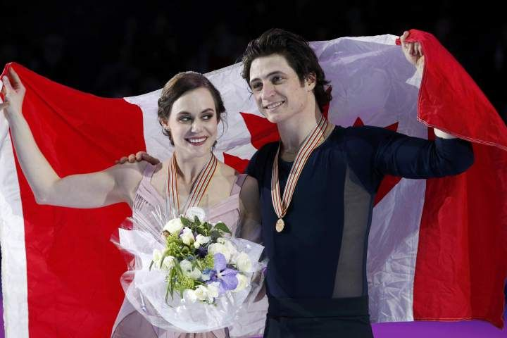 Gold medallists Tessa Virtue and Scott Moir of Canada attend the ceremony. (Photo via REUTERS/Grigory Dukor)