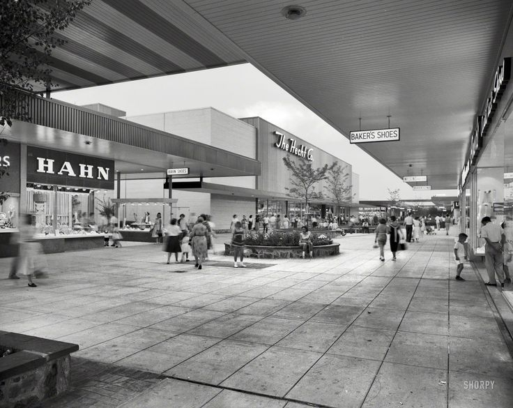 An actual mall (a long, open plaza) when it opened in 1959, the shopping center was enclosed in the 1970s and renamed the Mall at Prince Georges. Description from shorpy.com. I searched for this on bing.com/images
