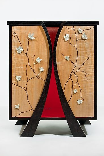 """Shinto: Emperor & His Queen""  Wood Cabinet  Created by Alison Swann-Ingram and Carl Johnson  Limited Edition  From a small series that explores the elegiac spiritualism of Imperial Japanese Dynasties, the night stands are made of a combination of pyrography, acrylic and hand cast silver leaves on casework of book matched Maple panel doors and Mahogany. Limited edition of 4. The interior of the cabinet is lit."