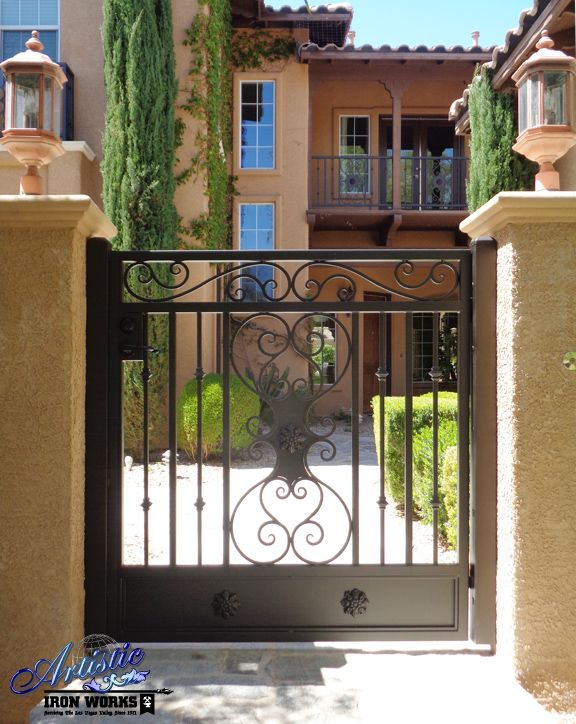 Decorative wrought iron courtyard entry gate