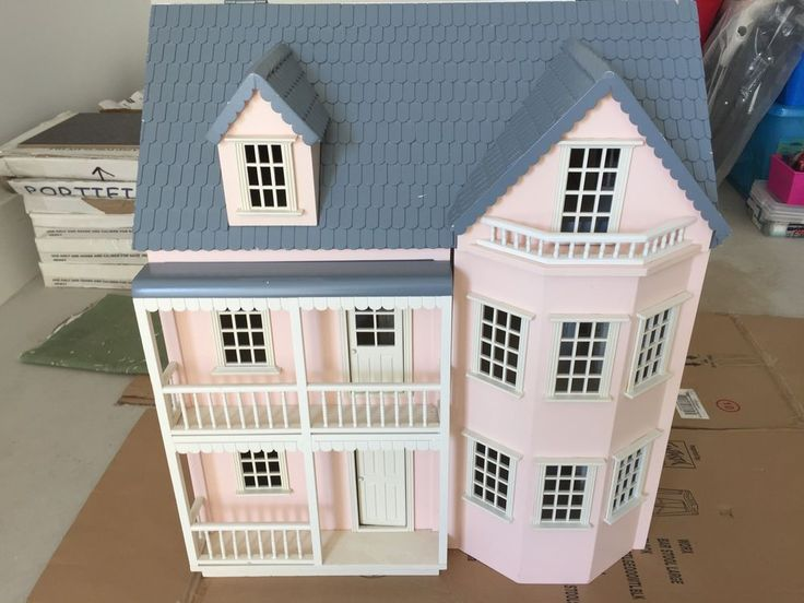 Large Wooden Dolls House with some furniture