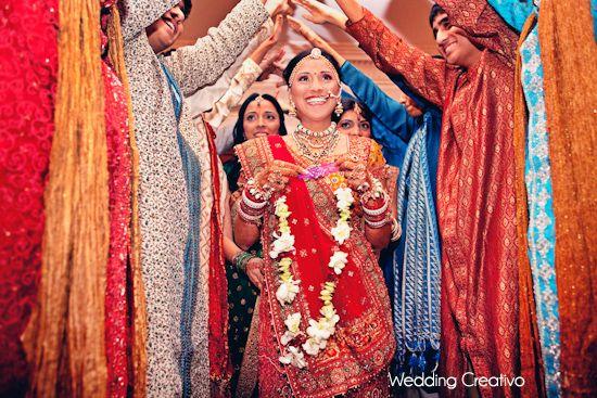 bride makes her entrance - Indian Wedding at Blackstone Hotel Chicago - Wedding Creativo