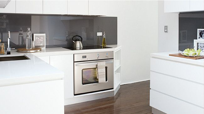Sleek kitchen makeover- like the bit next to the oven- would suit our house