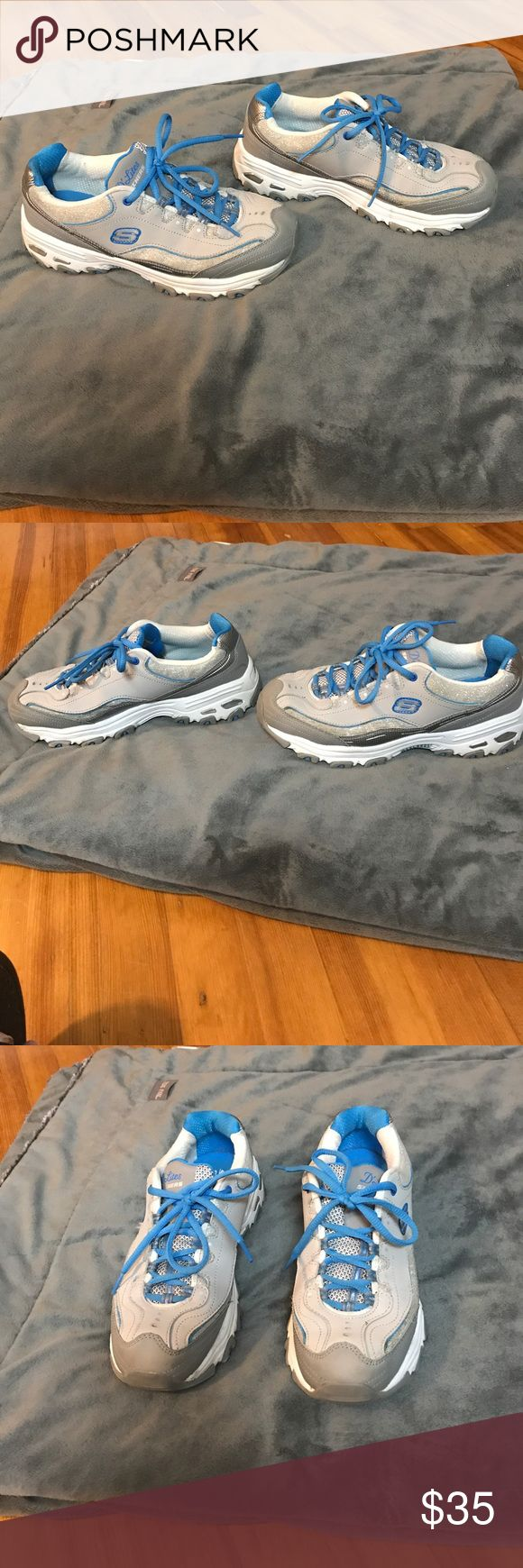 Skechers D' Lites Sport Shoes Worn once Skechers D' Lites Sport Shoes in size Women 8. These shoes are a grey and sky blue with metallic silver and then areas of silver glitter. Skechers Shoes Athletic Shoes