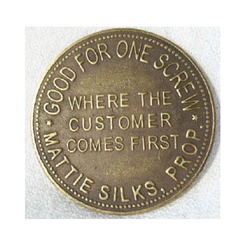 """A replica brass brothel or cat house token. One side has """"Good for One Screw Mattie Silks Prop."""" and """"Where the Customer Comes First"""". The other side has """"1942 Market Street Denver Colo."""" and """"Two Ups to your One Down""""."""