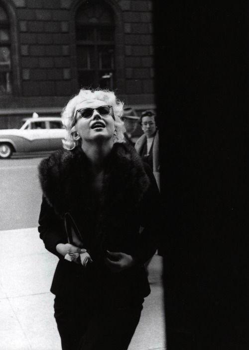 Marilyn entering Elizabeth Arden in New York by Ed Feingersh in March 1955.