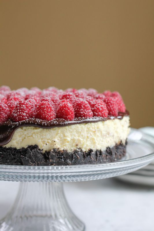 Raspberry Cheesecake with Oreo Crust with powdered sugar