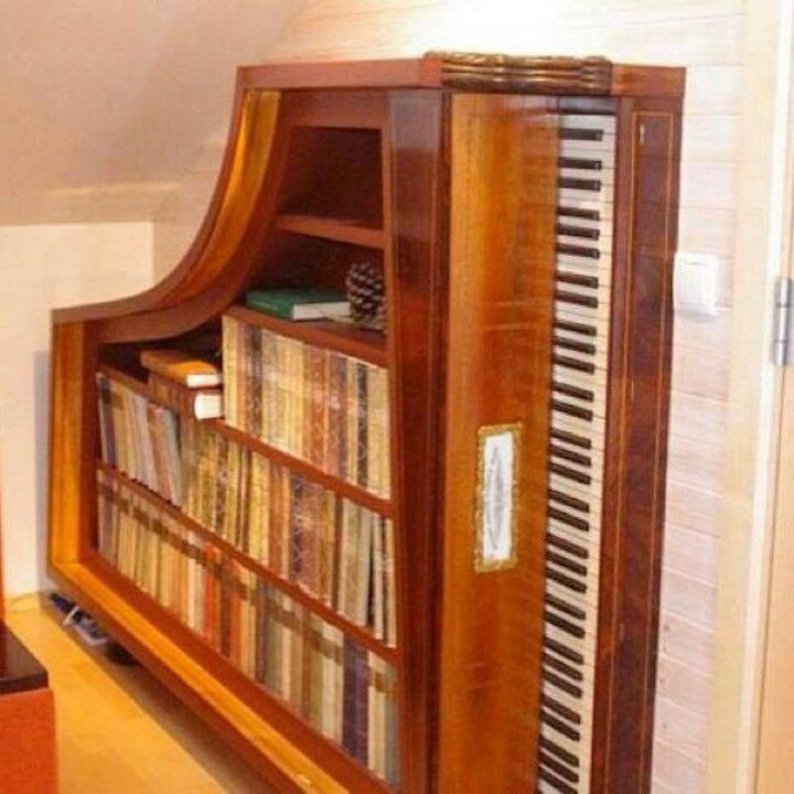 Repurposed Piano into Bookshelf. Pretty Awesome! I do not have a spare piano, but if the opportunity presents itself, I'd add this Statement Piece in a heartbeat!