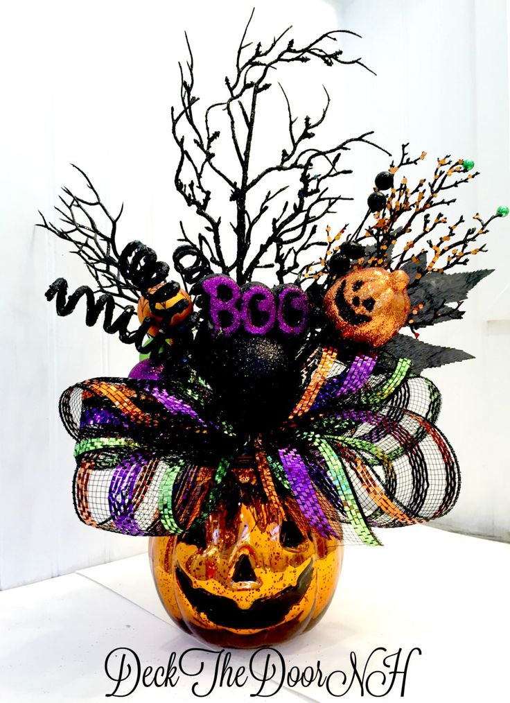 Pumpkin arrangement, Halloween arrangement, deco mesh pumpkin, Halloween table, Halloween Centerpiece, Witch boots by DeckTheDoorNH on Etsy https://www.etsy.com/listing/386597920/pumpkin-arrangement-halloween