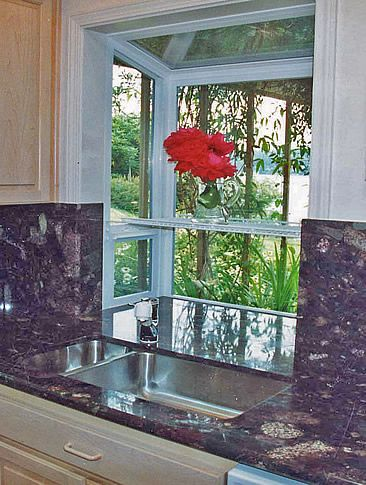greenhouse windows for kitchen   Counter flows into the bottom of the window. An optical addition of ...