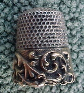 Sterling silver antique thimble who would put in this much work?